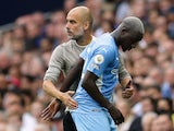 Manchester City's Benjamin Mendy with manager Pep Guardiola after being substituted on August 15, 2021