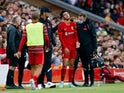 Liverpool's Curtis Jones receives medical attention after sustaining an injury in a tackle with Osasuna's Unai Garcia as Liverpool manager Jurgen Klopp looks on