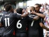 Everton's Dominic Calvert-Lewin celebrates scoring their second goal with teammates on August 28, 2021