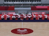Gold medalists, team members of Britain celebrate on the podium after winning gold in the wheelchair rugby at the Tokyo Paralympics on August 29, 2021