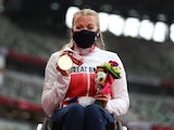 Gold Medallist Hannah Cockroft of Britain celebrates on the podium at the Tokyo Paralympics on August 29, 2021