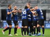 Inter Milan's Arturo Vidal celebrates scoring their third goal with teammates on August 21, 2021