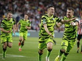 Forest Green Rovers' Jack Aitchison celebrates scoring their first goal with teammates on August 24, 2021