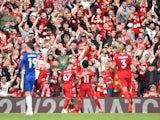 Liverpool's Mohamed Salah celebrates scoring their first goal with Harvey Elliott on August 28, 2021