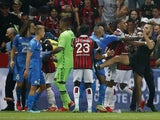 Pitch invaders clash with players as the game between Marseille and Nice is interrupted on August 22, 2021