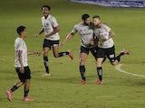 Atletico Mineiro's Eduardo Sasha celebrates scoring their first goal with teammates on August 23, 2021