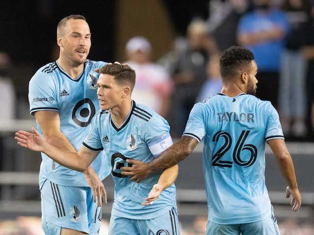 Minnesota United midfielder Will Trapp (20) is congratulated by defender Brent Kallman (14) and defender D.J. Taylor (26) for scoring a goal against the San Jose Earthquakes during the first half at PayPal Park on August 17, 2021