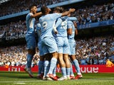 Manchester City's Ferran Torres celebrates scoring their second goal with teammates on August 28, 2021
