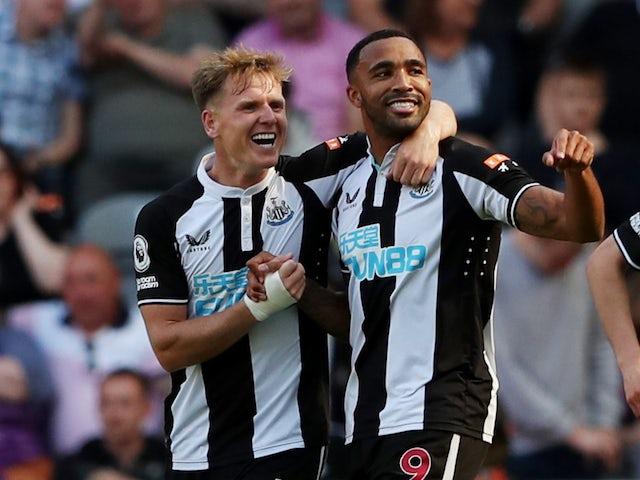 Newcastle United's Callum Wilson celebrates scoring their first goal with Matt Ritchie on August 28, 2021
