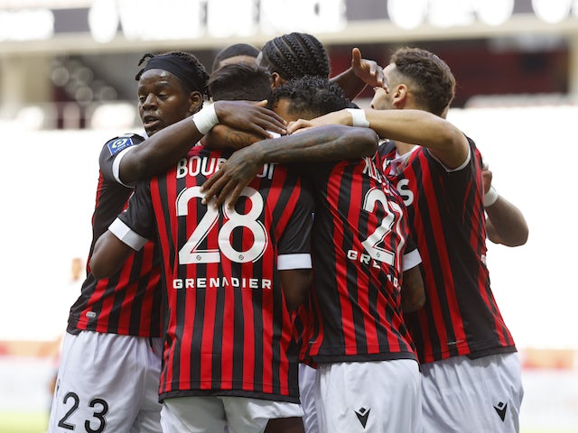 Nice's Hicham Boudaoui and Justin Kluivert celebrate scoring their first goal with teammates on August 28, 2021