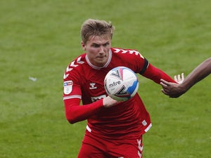 Bristol City centre-back Taylor Moore heads for Hearts