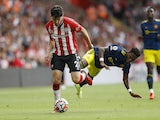 Southampton's Tino Livramento in action with Manchester United's Fred on August 22, 2021