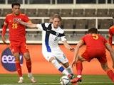 Finland's Fredrik Jensen in action with Wales' Thomas Alun Lockyer on September 1, 2021