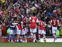 Arsenal's Pierre-Emerick Aubameyang celebrates scoring their first goal with teammates on September 11, 2021