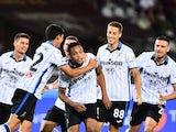 Atalanta's Luis Muriel celebrates scoring their first goal with teammates on August 21, 2021