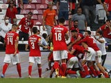 Benfica's Gilberto celebrates scoring their second goal with teammates in August 2021