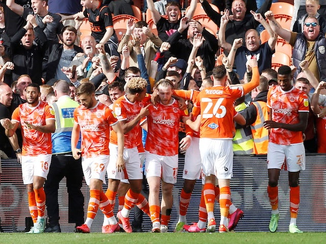 Blackpool's Josh Bowler celebrates with teammates after scoring their first goal on September 11, 2021