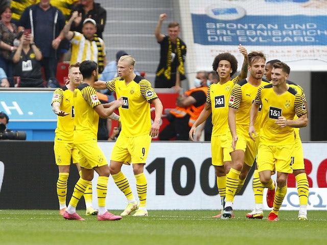 Borussia Dortmund's Erling Braut Haaland celebrates scoring their first goal with teammates on September 11, 2021