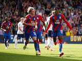 Wilfried Zaha celebrates scoring for Crystal Palace against Tottenham Hotspur in the Premier League on September 11, 2021