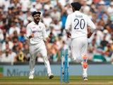 India's Virat Kohli and India's Axar Patel celebrate after England's Dawid Malan was run out on September 6, 2021