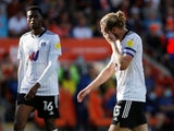 Fulham's Tim Ream looks dejected on September 11, 2021