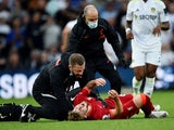Liverpool's Harvey Elliott reacts as he receives medical attention after sustaining an injury