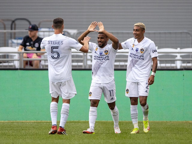 Los Angeles Galaxy midfielder Samuel Grandsir (11) celebrates his goal with defender Daniel Steres (5) and defender Julian Araujo (2) in the second half against the Colorado Rapids at Dick's Sporting Goods Park on September 11, 2021
