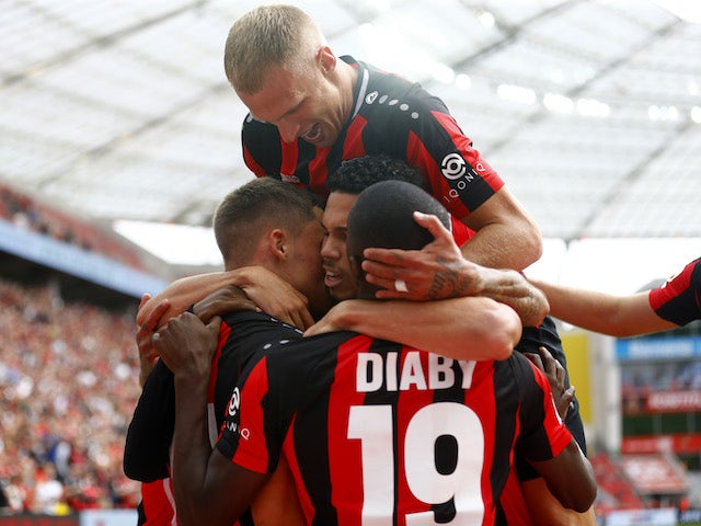 Bayer Leverkusen's Florian Wirtz and Moussa Diaby celebrate scoring their first goal with teammates on September 11, 2021