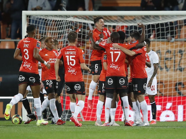 Lorient's Armand Lauriente celebrates scoring their first goal with teammates on September 10, 2021