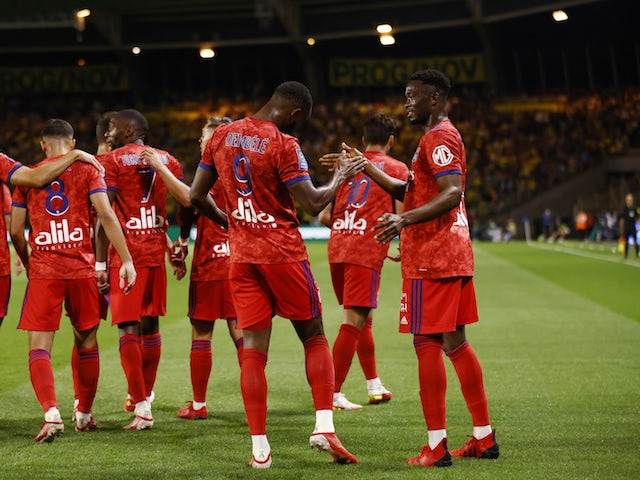 Lyon's Moussa Dembele celebrates scoring their first goal with teammates in August 2021