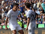 Manchester City's Bernardo Silva celebrates scoring their first goal with Rodri on September 11, 2021