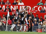 Newcastle United's Javier Manquillo celebrates scoring their first goal with teammates on September 11, 2021