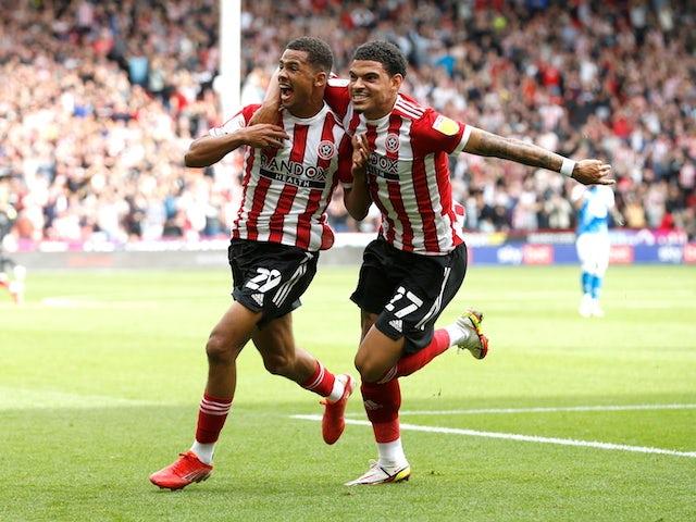 Sheffield United's Iliman Ndiaye celebrates scoring their first goal with Morgan Gibbs-White on September 11, 2021