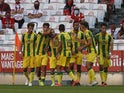 Tondela's Salvador Agra celebrates scoring their first goal with teammates in August 2021