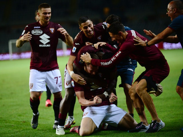 Torino's Andrea Belotti celebrates scoring their first goal with teammates on August 21, 2021