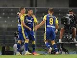 Hellas Verona's Ivan Ilic celebrates scoring their first goal with teammates on August 27, 2021