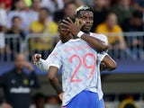 Manchester United's Paul Pogba hugs Aaron Wan-Bissaka after he was shown a red card against Young Boys on September 14, 2021