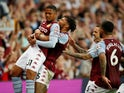 Aston Villa's Leon Bailey and Tyrone Mings celebrate after Everton's Lucas Digne scores an own goal in the Premier League on September 18, 2021