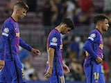 Barcelona's Gerard Pique, Yusuf Demir and Philippe Coutinho look dejected after the match on September 14, 2021