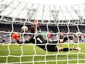 West Ham United's Mark Noble has his penalty saved by Manchester United's David de Gea on September 19, 2021
