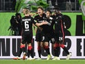Eintracht Frankfurt's Sam Lammers celebrates scoring their first goal with teammates on September 19, 2021