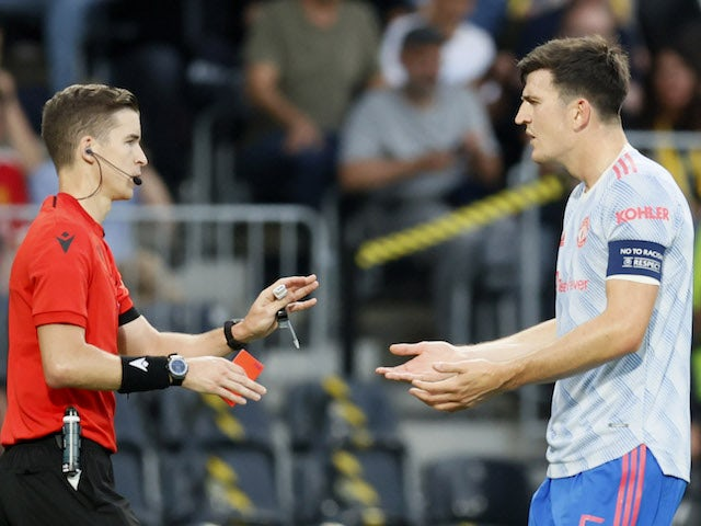 Harry Maguire reacts to Aaron Wan-Bissaka red card