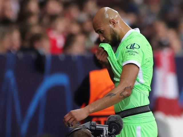 Wolfsburg's John Brooks walks off dejected after receiving a red card on September 14, 2021