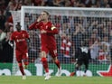 Liverpool's Jordan Henderson celebrates scoring against AC Milan on September 15, 2021