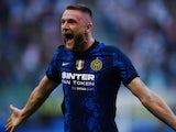 Inter Milan's Milan Skriniar celebrates scoring against Genoa on August 21, 2021