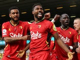 Watford's Emmanuel Dennis celebrates scoring their first goal against Norwich City in the Premier League on September 18, 2021