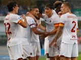 Roma's Lorenzo Pellegrini celebrates scoring their first goal with teammates on September 19, 2021