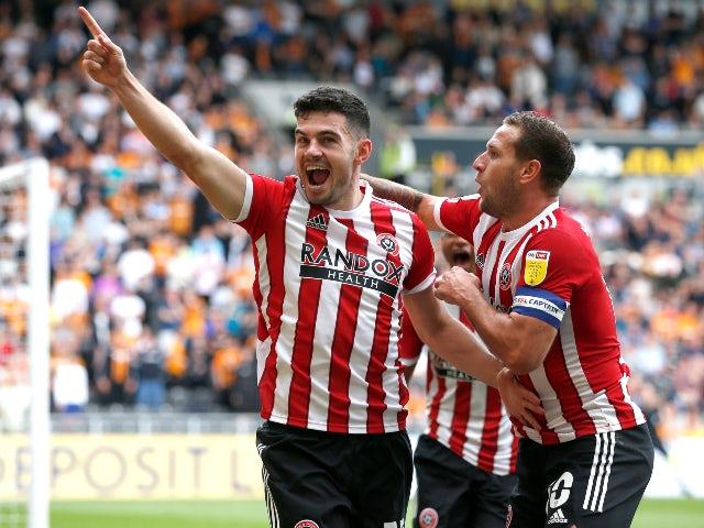 Sheffield United's John Egan celebrates scoring their second goal against Hull City in the Championship on September 18, 2021