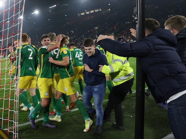 Preston North End's Emil Riis celebrates scoring their second goal with teammates on September 14, 2021