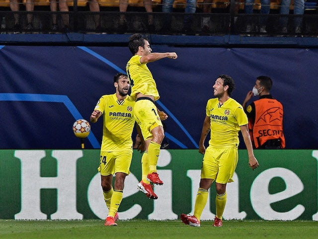 Villarreal's Manu Trigueros celebrates scoring their first goal with teammates on September 14, 2021